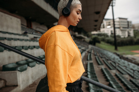 Fitness woman walking down the stairs of a stadium