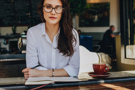 Confident woman at coffee shop