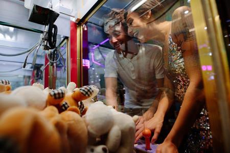 Couple at a gaming arcade
