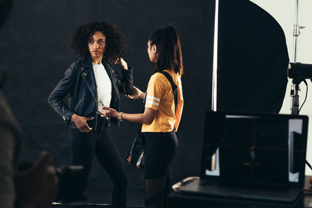 Stylist adjusting model during a fashion shoot