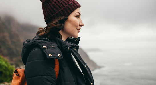 Female traveler admiring the view from mountain