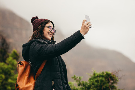 Traveler talking a selfie on hill top