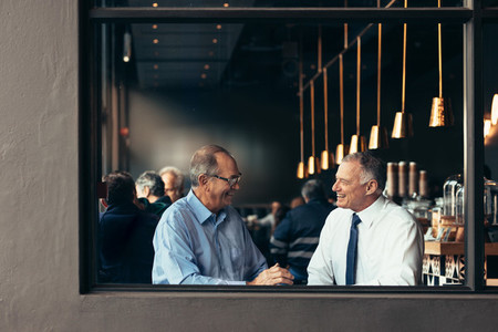 Business partners having a casual discussion at cafe