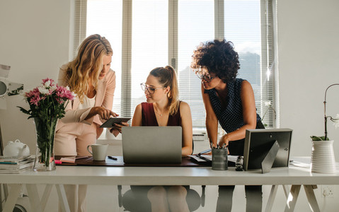 Group of businesswomen working together in office