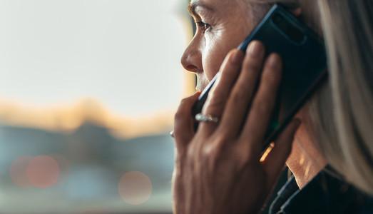 Senior business woman making a phone call