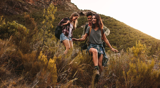 Young people hiking on a rough terrain