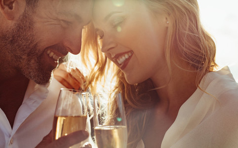 Romantic couple with wine outdoors
