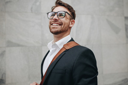 Close up of a smiling businessman looking away