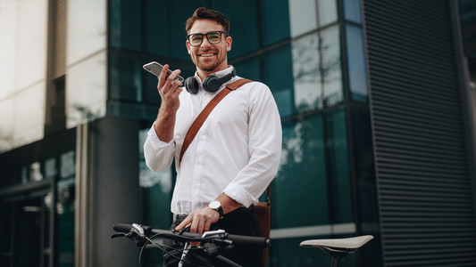 Man standing in front of office talking on mobile phone