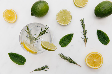 Gin tonic cocktail drink with green lime white background