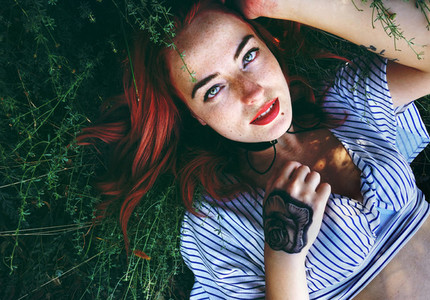 Redhead woman in nature
