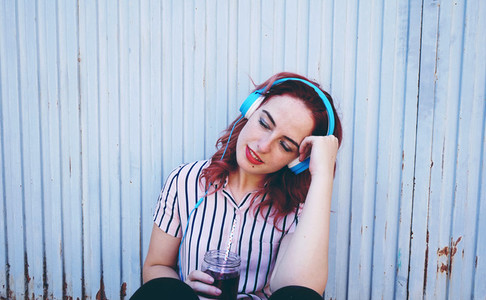 Beautiful redhead woman listening to music