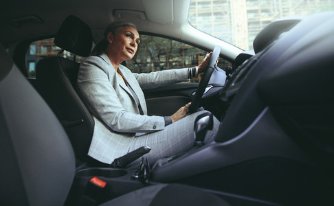 Mature woman driving a car