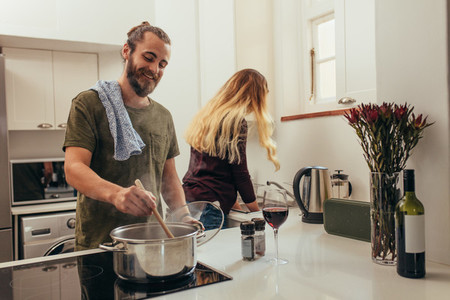Couple doing kitchen work together at home