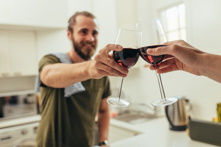 Man toasting wine with a friend