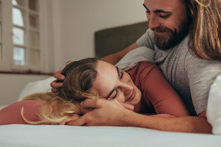 Couple in bed spending time together sharing love