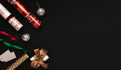 Christmas decoration flat lay on black background