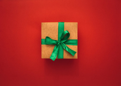 Gift box on red background