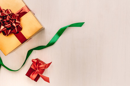 Gift boxes with ribbon on wooden background