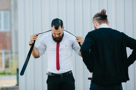 two businessmen prepared to work