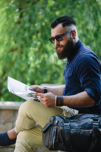 bearded man looking at a map