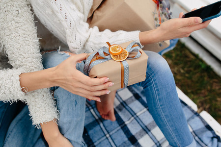Girls sit on a bench and shoot gifts