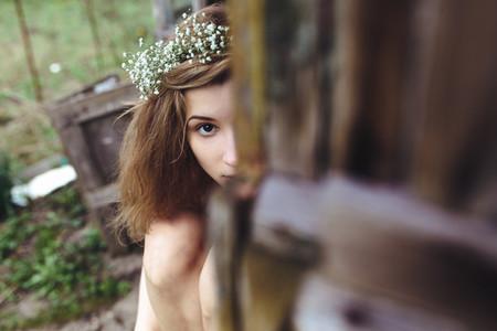 Beautiful girl spying on someone
