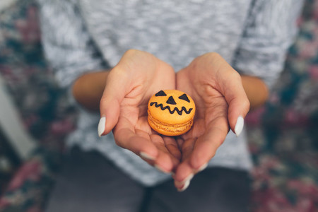 woman sitting and holding a cookie