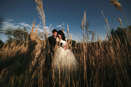Lovely couple spends time in the field