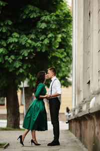 European beautiful couple posing on the street