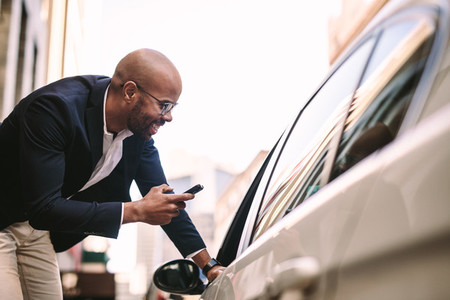 Businessman talking with cab driver on road