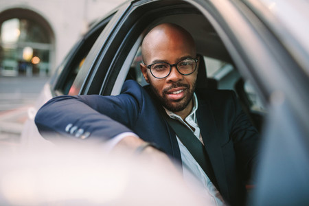 African businessman enjoying the driving car