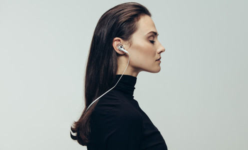Woman in black with earphones