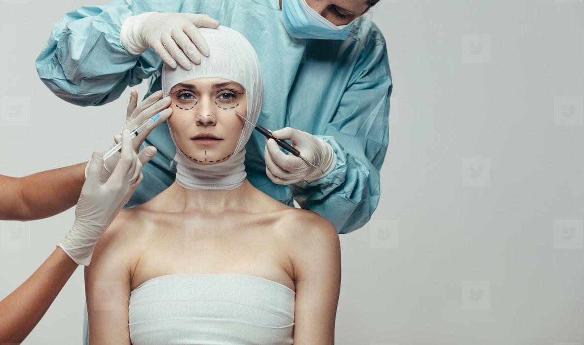 Woman under going face lift surgery