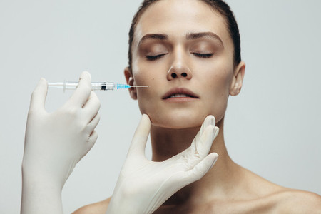 Woman gets beauty facial injections