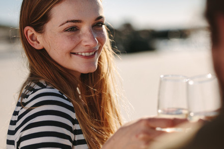 Beautiful woman toasting champagne with her boyfriend