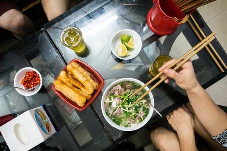 Girl eating Vietnamese noodle