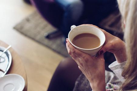Girl enjoying milk coffee