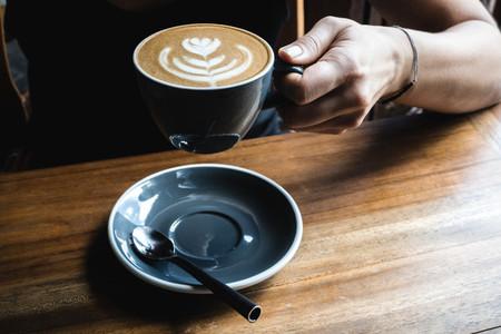 Girl having a cappuccino coffee