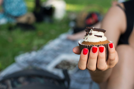 Girl holding a cupcake