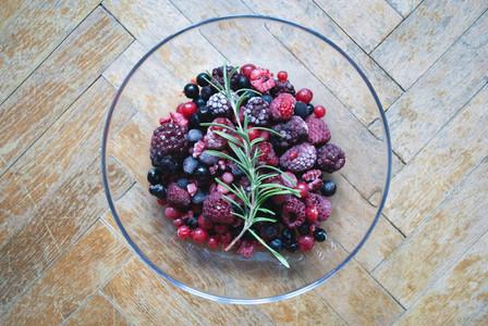 Glass bowl of frozen berries