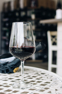 Glass of red wine in a wineshop