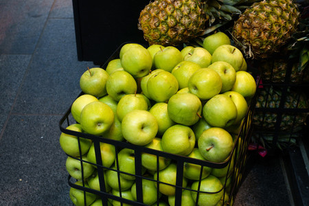 Green apples in shopping trolley