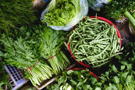 Greens and bean pods at market