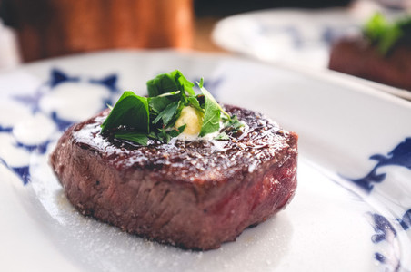 Grilled filet mignon with herbs
