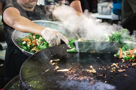 Grilling vegetables at market