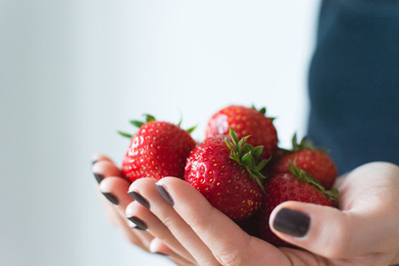 Lady holding fresh strawberries