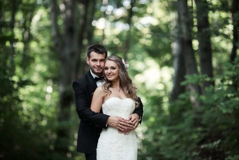 Beautiful wedding couple posing in forest