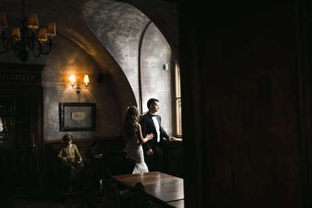 The bride and groom in a cozy house  photo taken with natural li