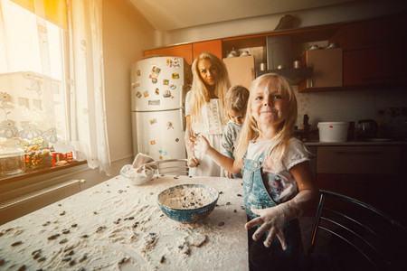 Mother with kids on kitchen